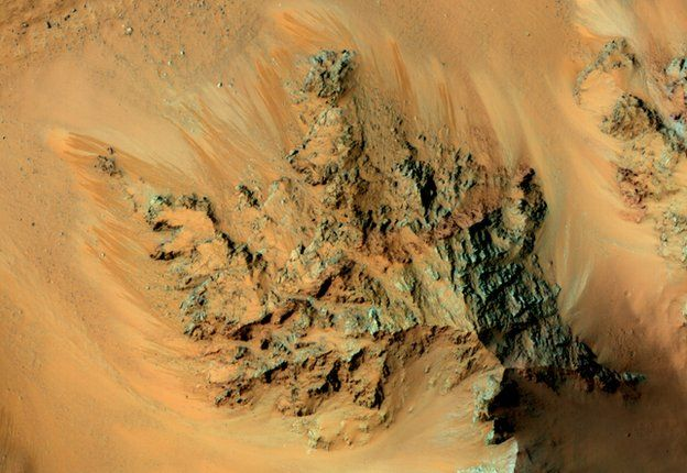 Streaks known as recurring slope lineae may be caused by seeping water